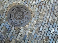 Blue Cobblestones and Manhole