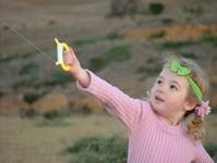 Girl Flying a Kite