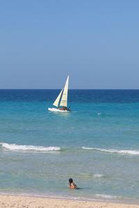 Sailboat cruises past Cuban be