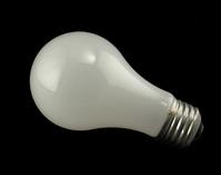 Lightbulb on black stock photos