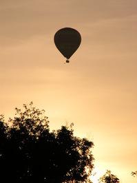 Balloon against orange sky