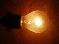 bulb against orange stock photo