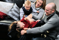 Family tickling each other