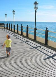Boy on boardwalk