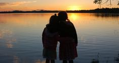 Little girls watching sunset