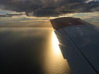 Dawn sky from small aeroplane